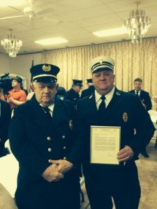 2nd Assistant Chief Steve Hummel (right), with his father, Past District Chief Dick Hummel. Missing: Barry Morehouse